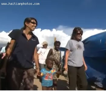 Sarah Palin Accompagned By A Haitian Child