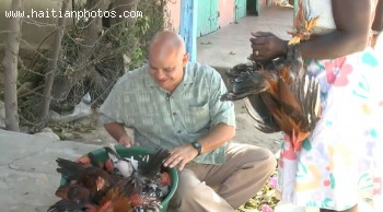 Frere Joel Of La Bonne Nouvelle Buying Chicken In Haiti