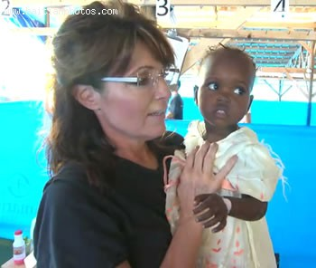 Sarah Palin Holding Haitian Child