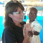 Sarah Palin Holding Haitian Child