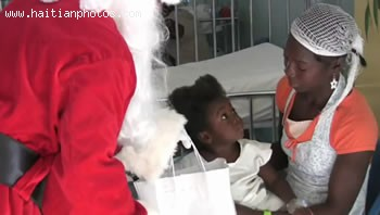 Santa Clause Bringing Gift To A Haitian Child On Christmas