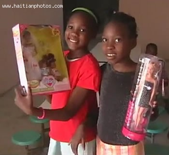 Two Haitian Children Receiving Christmas Gifts
