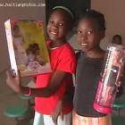Two Haitian Children Receiving Christmas Gifts