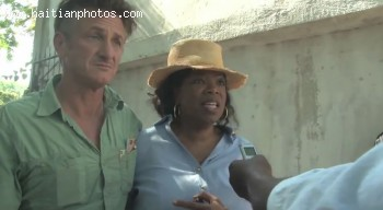 Oprah Winfrey with actor Sean Penn in Haiti filming Oprah's next Chapter