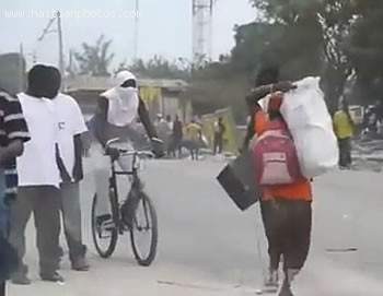 Looters Running In Haiti Following Earthquake