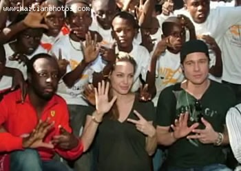 Angelina Jolie And Brad Pitt Along With Wyclef Jean In Haiti