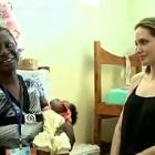 Angelina Jolie Talking To A Staff Member In Haiti