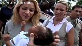 Shakira Admiring A Baby In Haiti