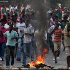 Protest Tire Burning Haitians