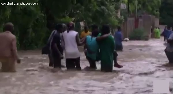 Hurricane Sandy In Haiti, Beeing Carried By Several People