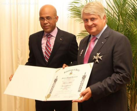 Michel Martelly decorates Digicel CEO Denis O'Brien