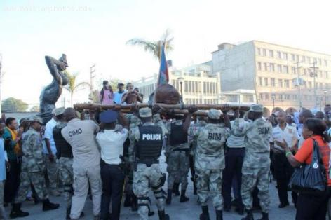 Kita Nago being carried by Haitian Police