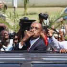Jean Bertrand Aristide Blowing Kisses to supporters