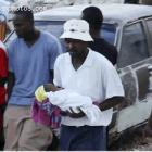 Man With Child - Haiti Earthquake - January 12, 2010