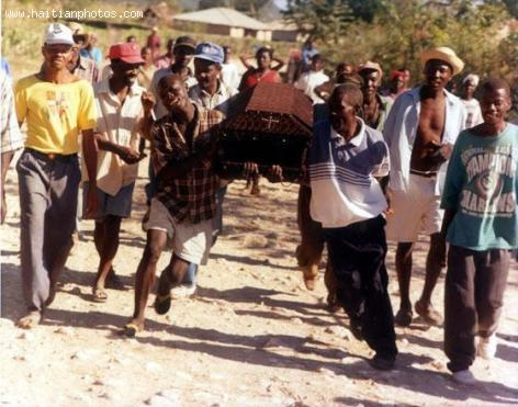 Funeral in Haitian Culture - Prayer and crying