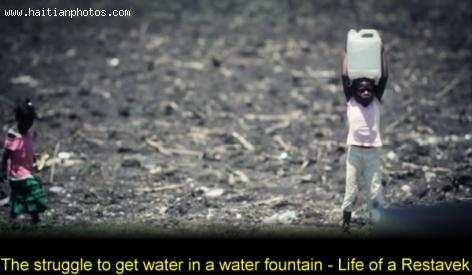 The struggle to get water in a water fountain in Haiti - Life of a Restavek