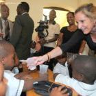 U.S. Ambassador Pamela Ann White distributing medicine