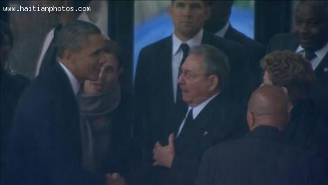 Historic handshake between Obama and Raul Castro
