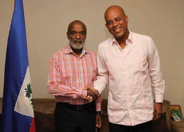 Rene Preval in Pink with Michel Martelly, has he converted into Tet Kale?