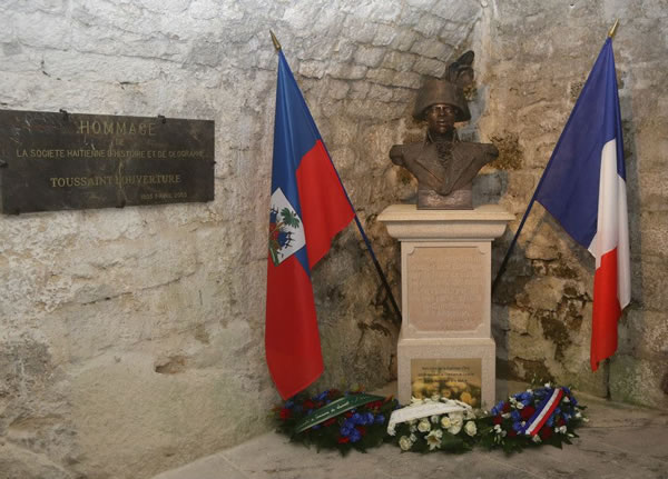 Toussaint Louverture's Statue With French and Haitian Flag at Fort de Joux