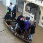 Boat in the street of Cap-Haitian due to flood