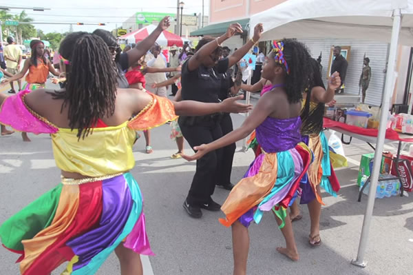 Miami Police Officer dancing Rara Lakay in Little Haiti