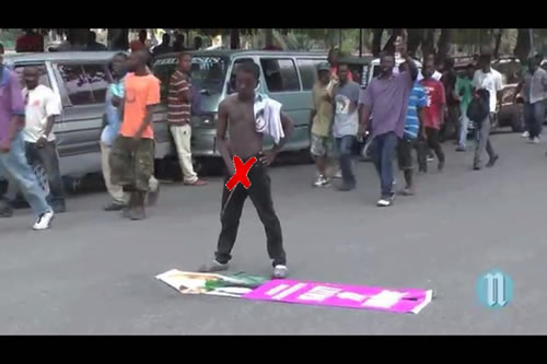 Destroying Michel Martelly's Picture to express anger against the Government