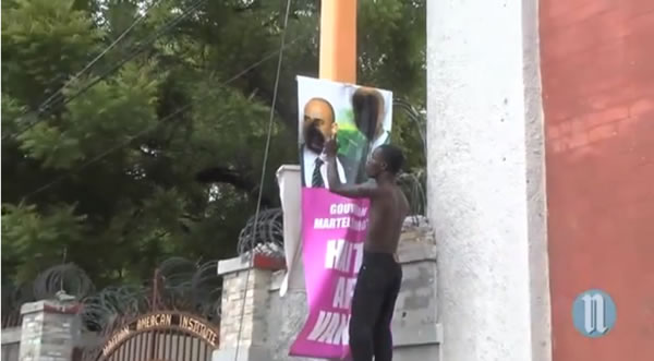 Spray painting of Martelly and Lamothe Picture during Protest