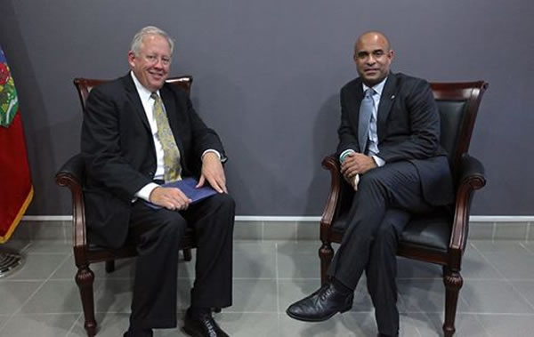 Prime Minister Lamothe discusses with US envoy Thomas Shannon.   The clock is ticking as pressure mounting on Haiti's government to resolve dispute ov
