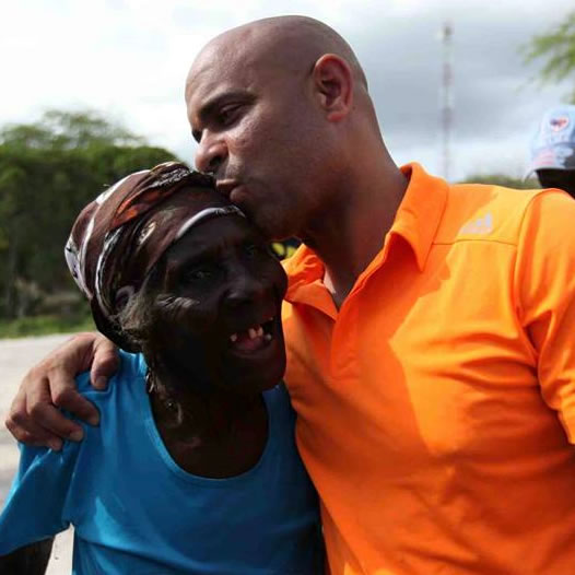 Prime Minister Laurent Lamothe with an elderly Haitian Woman