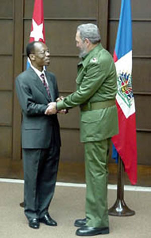 Former Haitian President Jean Bertrand Aristide with Fidel Castro of Cuba