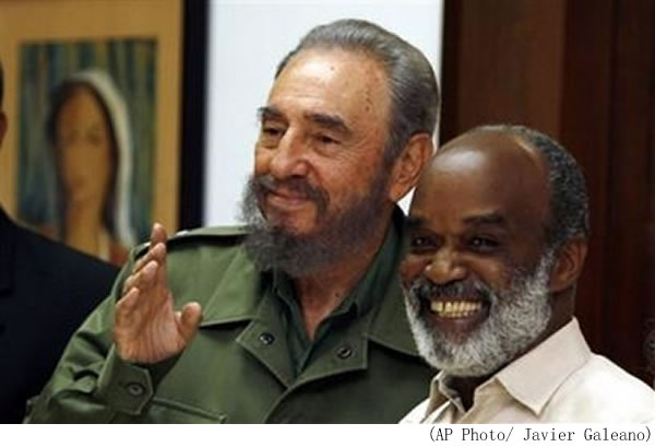Rene Preval smiles as he is welcomed by Cuban President Fidel Castro