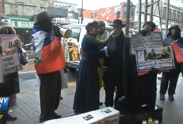 Protesters outside Clinton Foundation, asking about missing Haiti Recovery fund