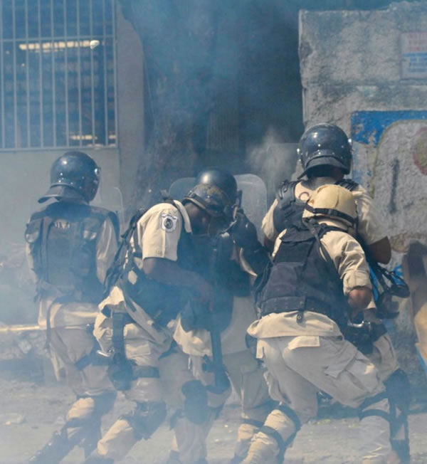 Haitian Police uses donated PBSO Riot Gear against anti-goverment protests