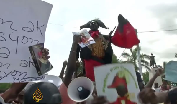 Francois Hollande in Haiti protesters demand reparations