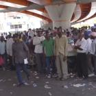 Undocumented Haitians Dominican Sugar cane Workers wait in long lines