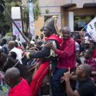 Moise Jean Charles on horseback riding during Protest