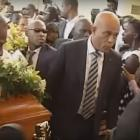 President Martelly carrying Black Alex's coffin
