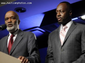 Haitian President Rene Preval And Wyclef Jean
