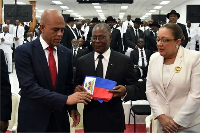 Michel Martelly returning presidential sash to National Assembly