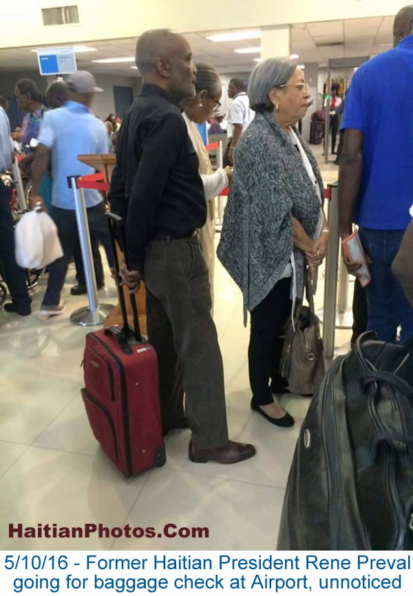 Rene Preval going for baggage check at Airport