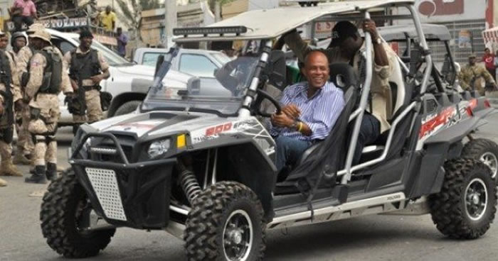 President Michel Martelly riding a Polaris
