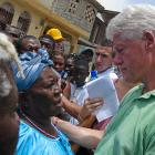 Bill Clinton listening to a woman in Haiti
