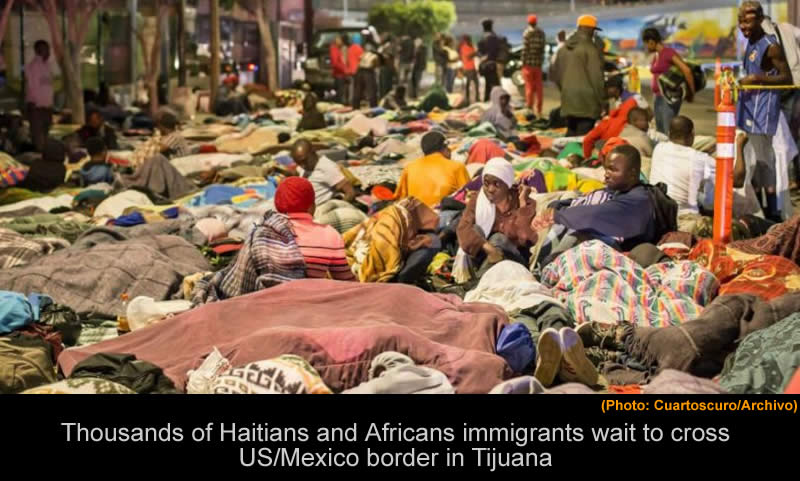 Haitians immigrants wait to cross US/Mexico border in Tijuana