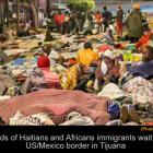 Haitians immigrants wait cross