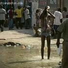 Gentleman Taking Shower In The Street In Haiti