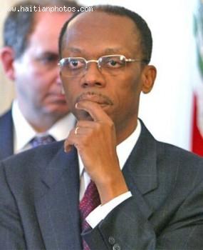 Ira Kurzban On The Background Of President Jean-Bertrand Aristide
