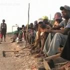 Haitians Waiting To Go On The Field To Cut Sugar Cane In Batey - Dominican Republic