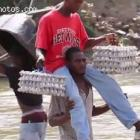 Haitians Crossing The Border Between Haiti And Dominican Republic With Egg Carton
