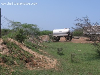 Picture Of Nepalise U.N. Tanker Truck Dumping Excrements